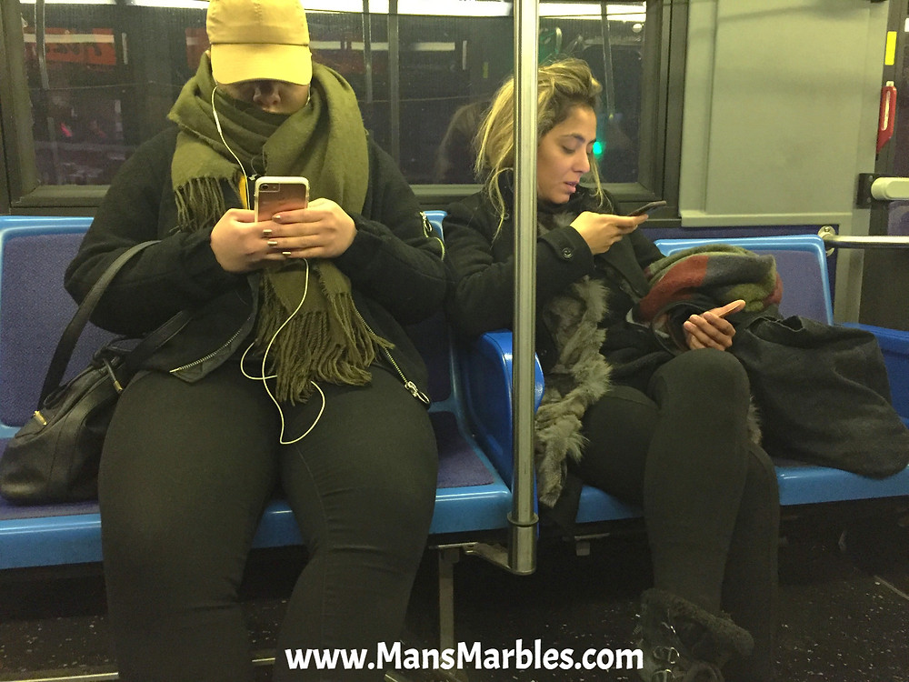 2 woman hogging 4 seats with theirs bags on nyc bus
