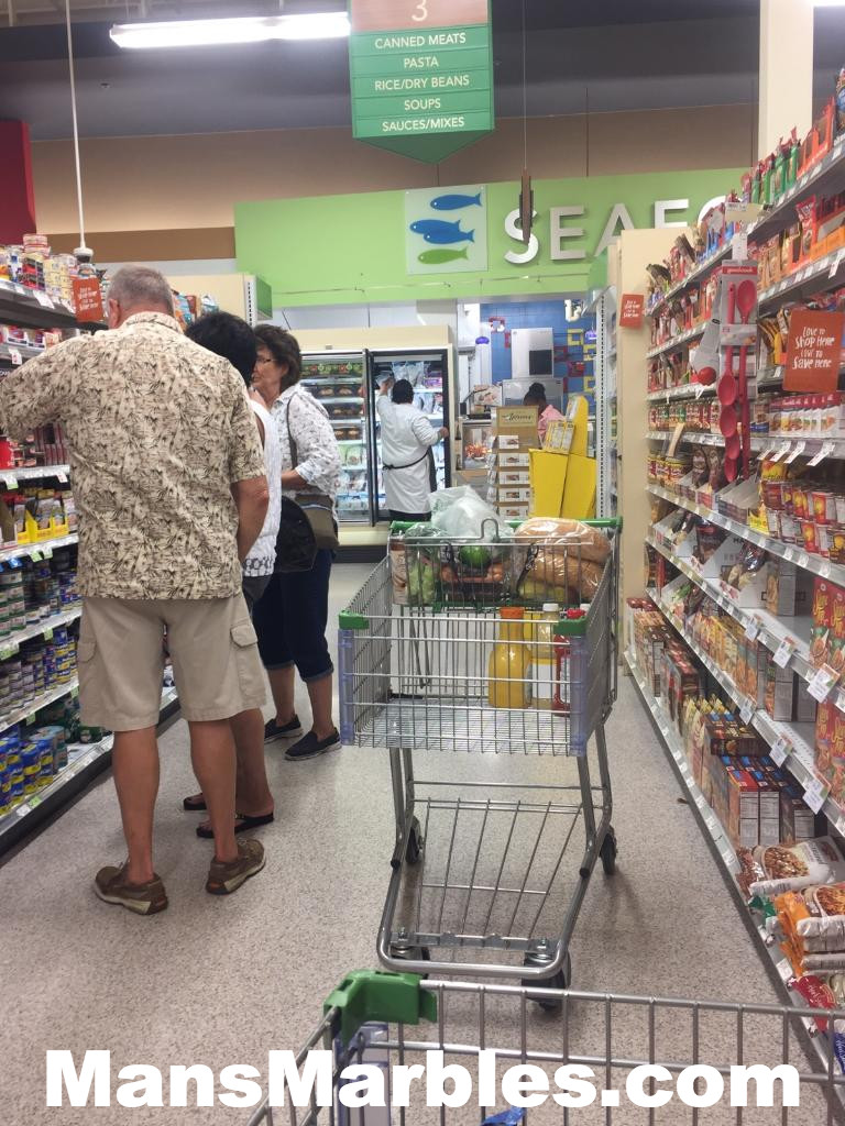 Shoppers blocking an aisle with their shopping cart in the grocery store
