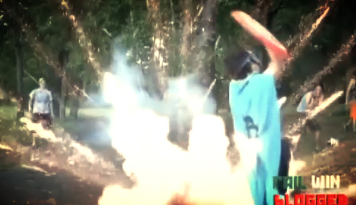 Moronic kid dressed as Captain America trying to sheild himself from exploding firework shot at him by friend