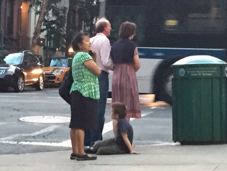 Nanny Chats on Phone While Kid Plays on Dirty NYC Sidewalk