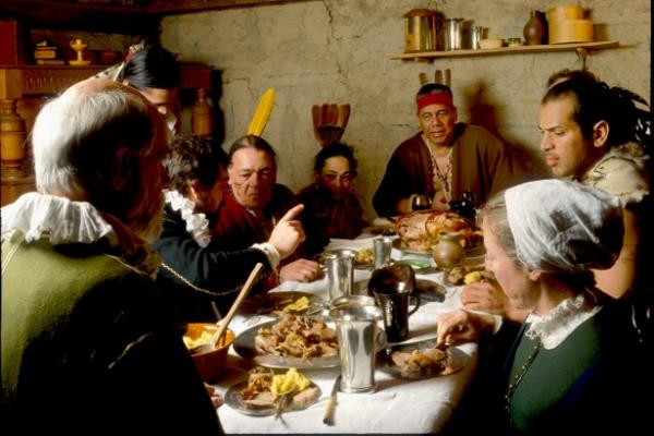 Pilgrims and first Americans celebrating Thanksgiving