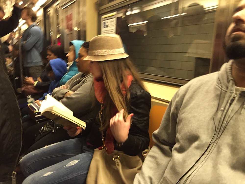 reading a book while womanspreading on a packed NYC train #6