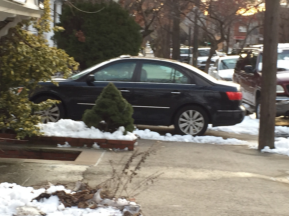 Jan 26, 2015 Car parked on sidewalk before winter storm Juno, blocks pedestrians from walking safely