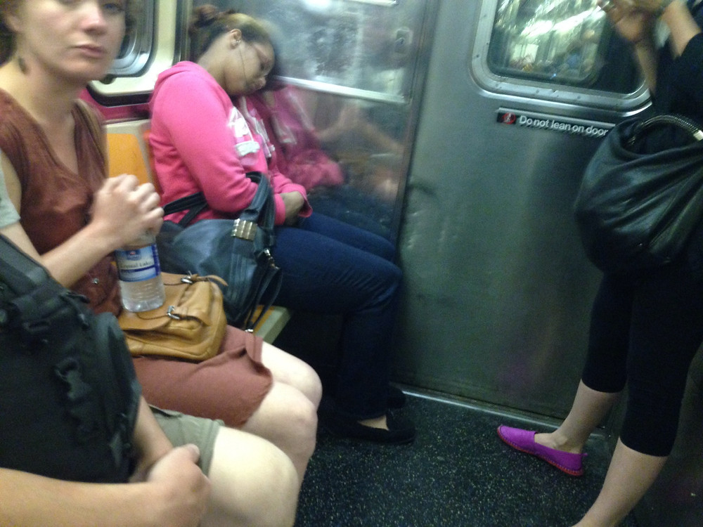 girl pretends to slepp so nobody ask her to move her bagspread #2