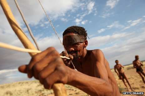 African tribesman hunting with a bow and arrow