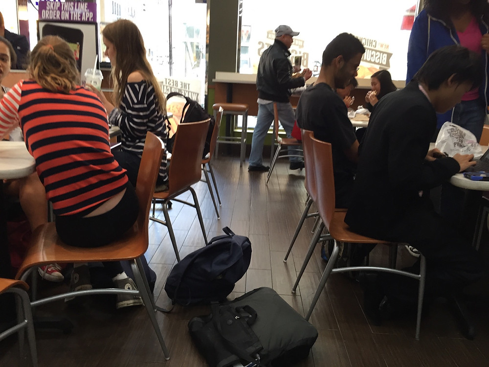 Students bagpreading on the floor in Taco Bell, forces man to step over them #7