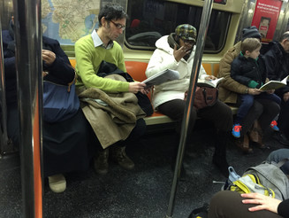 A Man Bagspreading and a Woman Manspreading