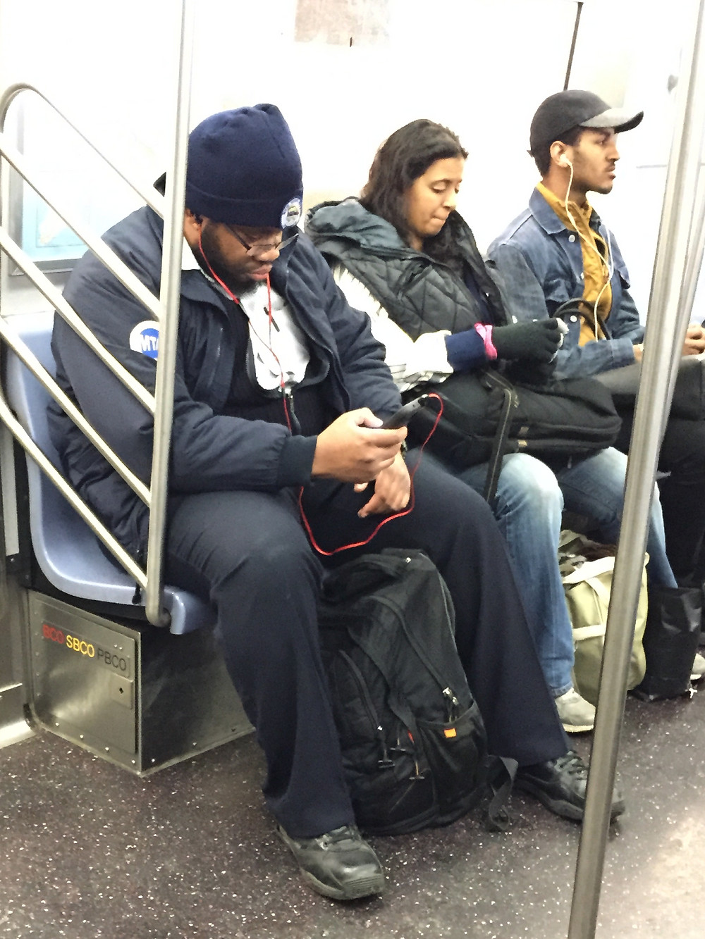 MTA employee manspreading in NYC despite the MTA's courtesy counts campaign #2