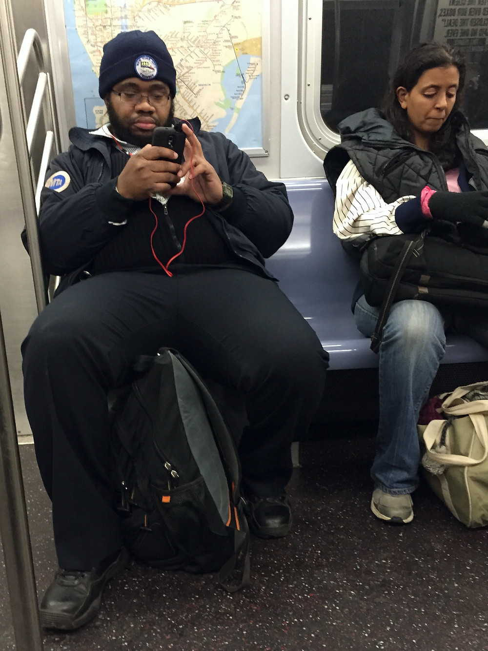 MTA employee manspreading in NYC despite the MTA's courtesy counts campaign #1