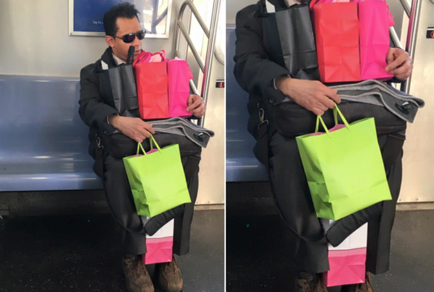 Male commuter taking up minimal space with many bags on nyc subway train