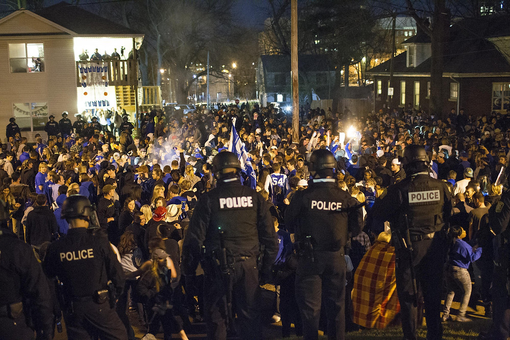 riot police keeping the peace on stae street after kentucky loses to wisconsin