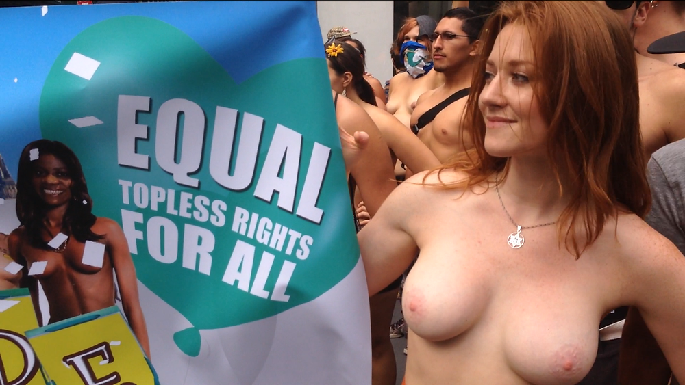 Rachel Jessee holding Equal Topless Rights Banner at NYC's Go Topless Pride Parade