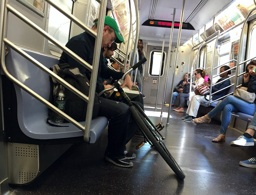 A hipster womanspreading, bagspreading, manspreading, and bikespreading in NYC #2