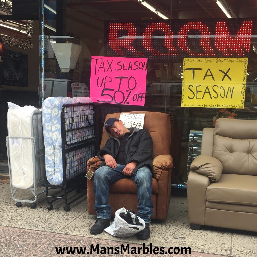 Guy sleeping on store's floor model reclining chair