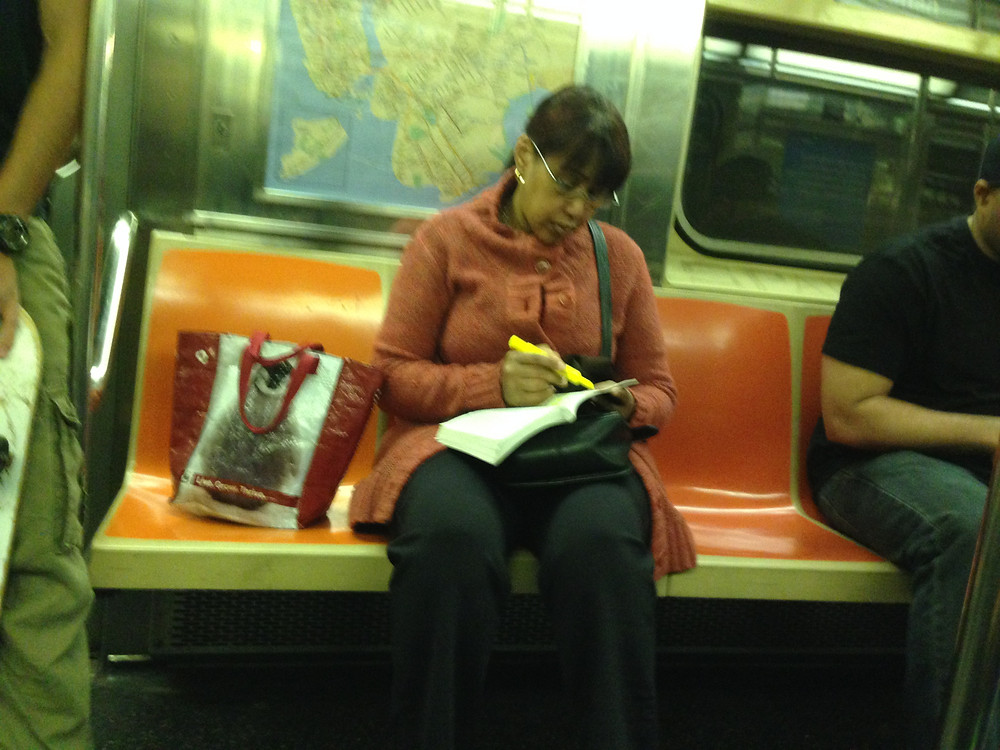 Bagspreading woman highlighting a book #2