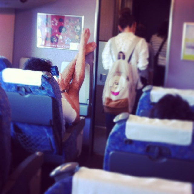 Passenger Shaming, man with stinky, bare feet propped up on plane wall near the cockpit