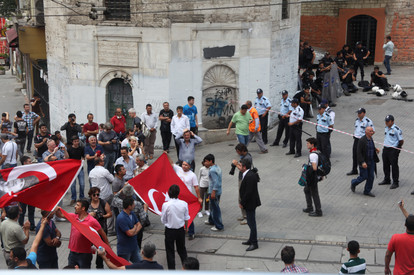 Crowd holding flag, Gezi Protest, Istanbul 2013