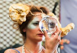 Girl in staring in glass ball