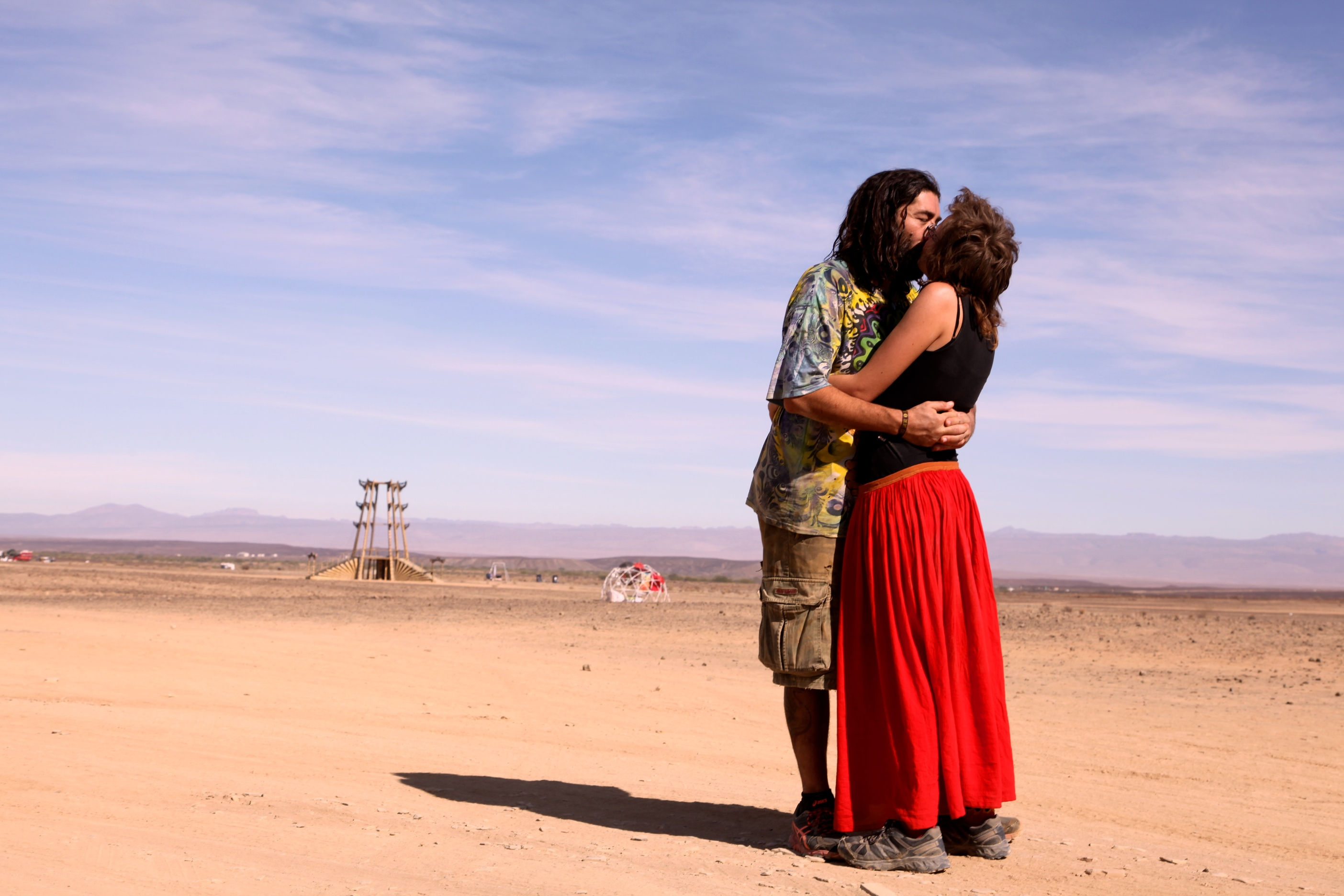 Lovers embrace in Afrikaburn