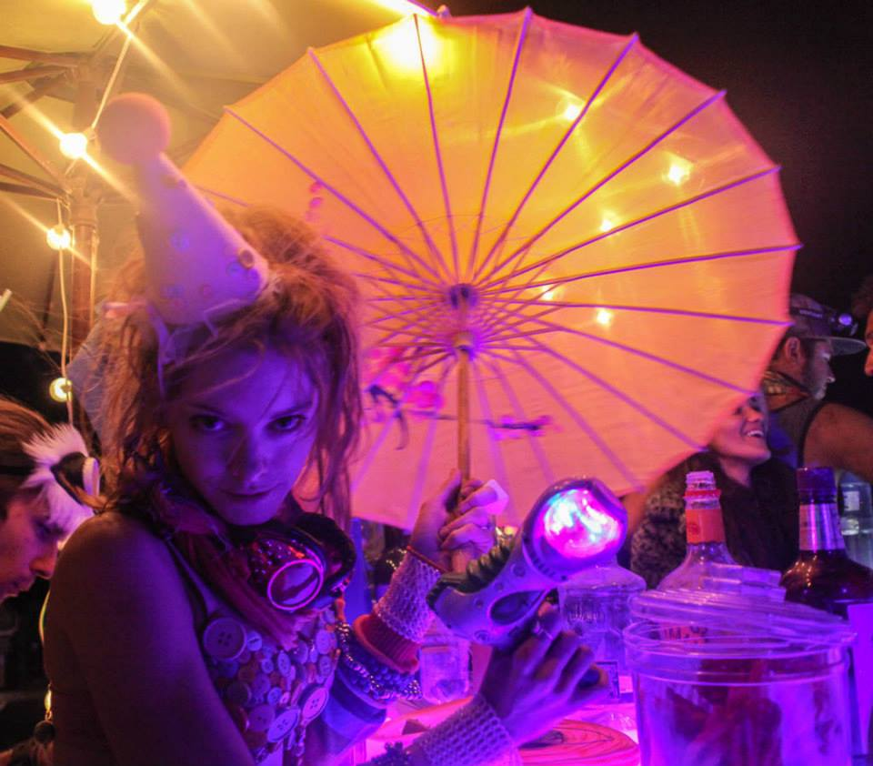 Burning Man girl holding parasol