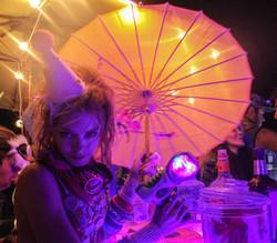 Burning Man girl holding parasol