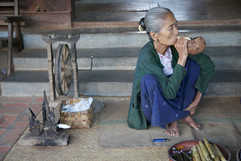 Woman in Myanmar smoking