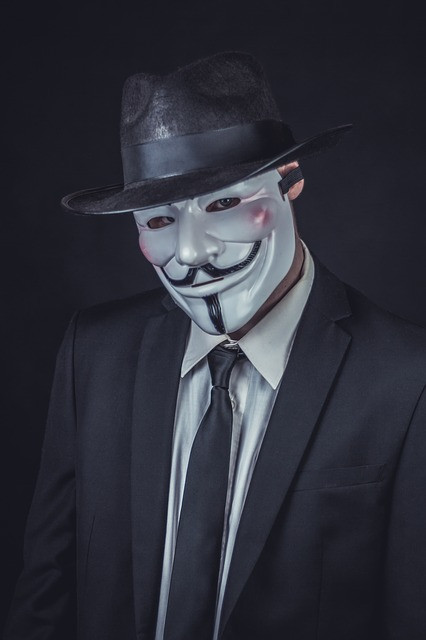 man in black hat and mask