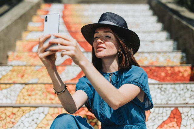 Woman taking selfie on colorful steps