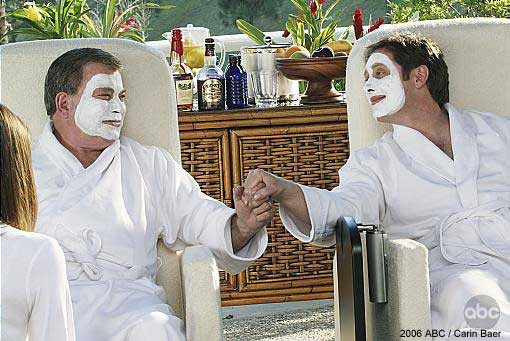 Two men holding hands at a spa