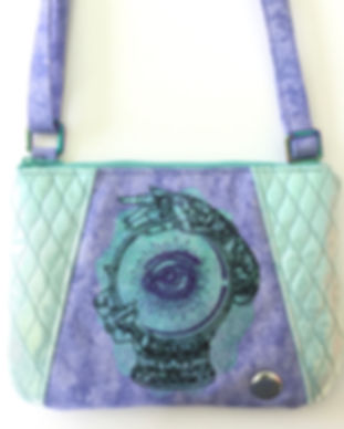 crossbody bag with shimmering embroidered mystical eye in a crystal ball