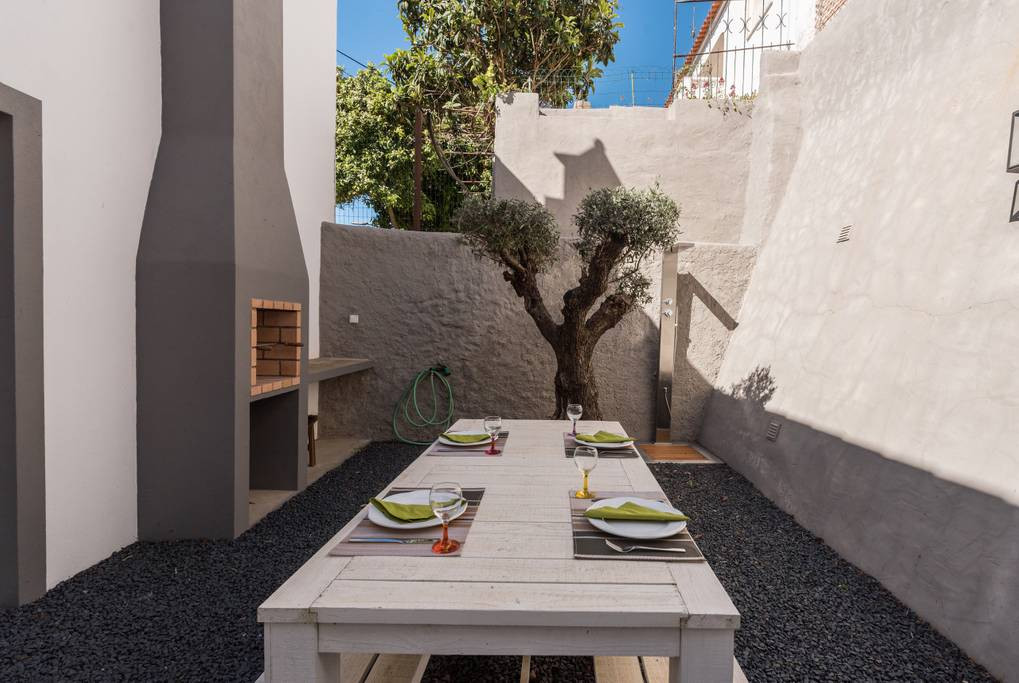 outside dining under the olive tree