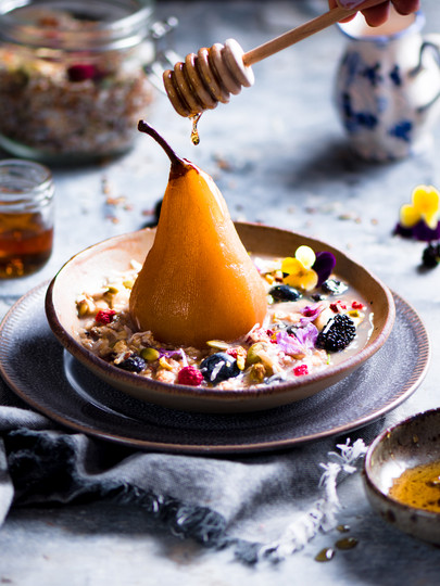 Poached pear in bircher muesli photography