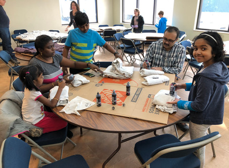 St. Barnabas Volunteers Process Shirts For Matthew 25: Ministries