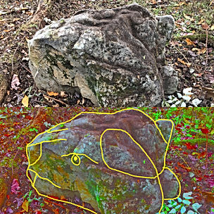 upper stone circle top bottom lion head.