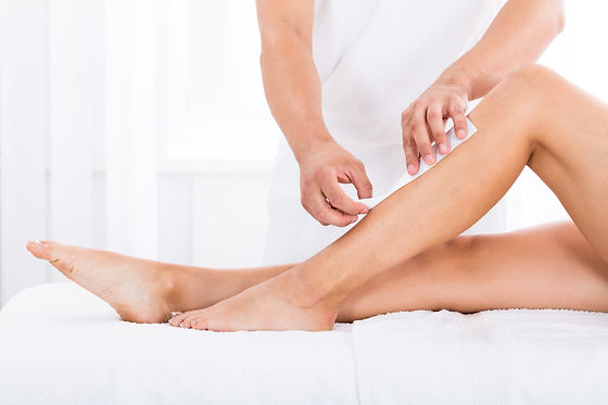 Close-up Of A Beautician Waxing Woman's