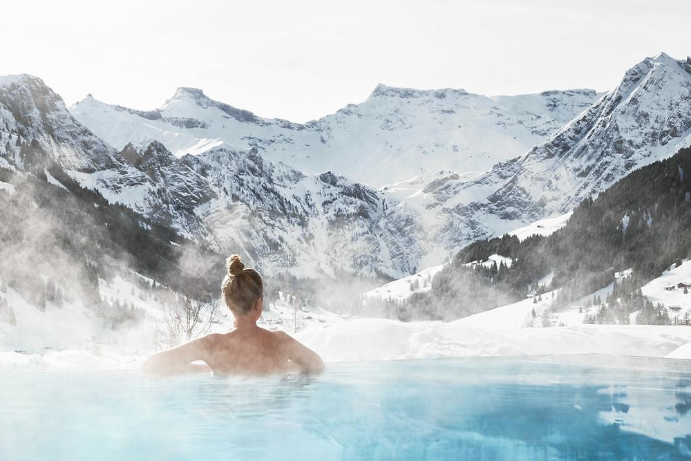 Swiss Alps infinity pool view at Cambrian Hotel in Switzerland