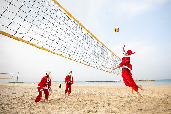 DECEMBER 23, 2020 - Tel Aviv-Yafo welcomes volleyball-playing Santas to Gordon Beach
