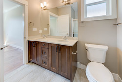 Dark-stained bathroom cabinetry