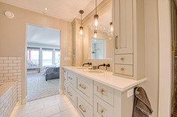white painted vanity cabinets to match kitchen