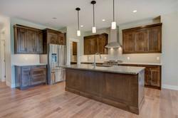 Dark-stained kitchen cabinets