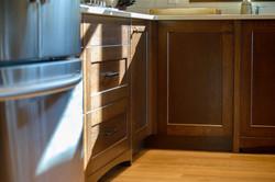 Custom woodwork on cabinet edges