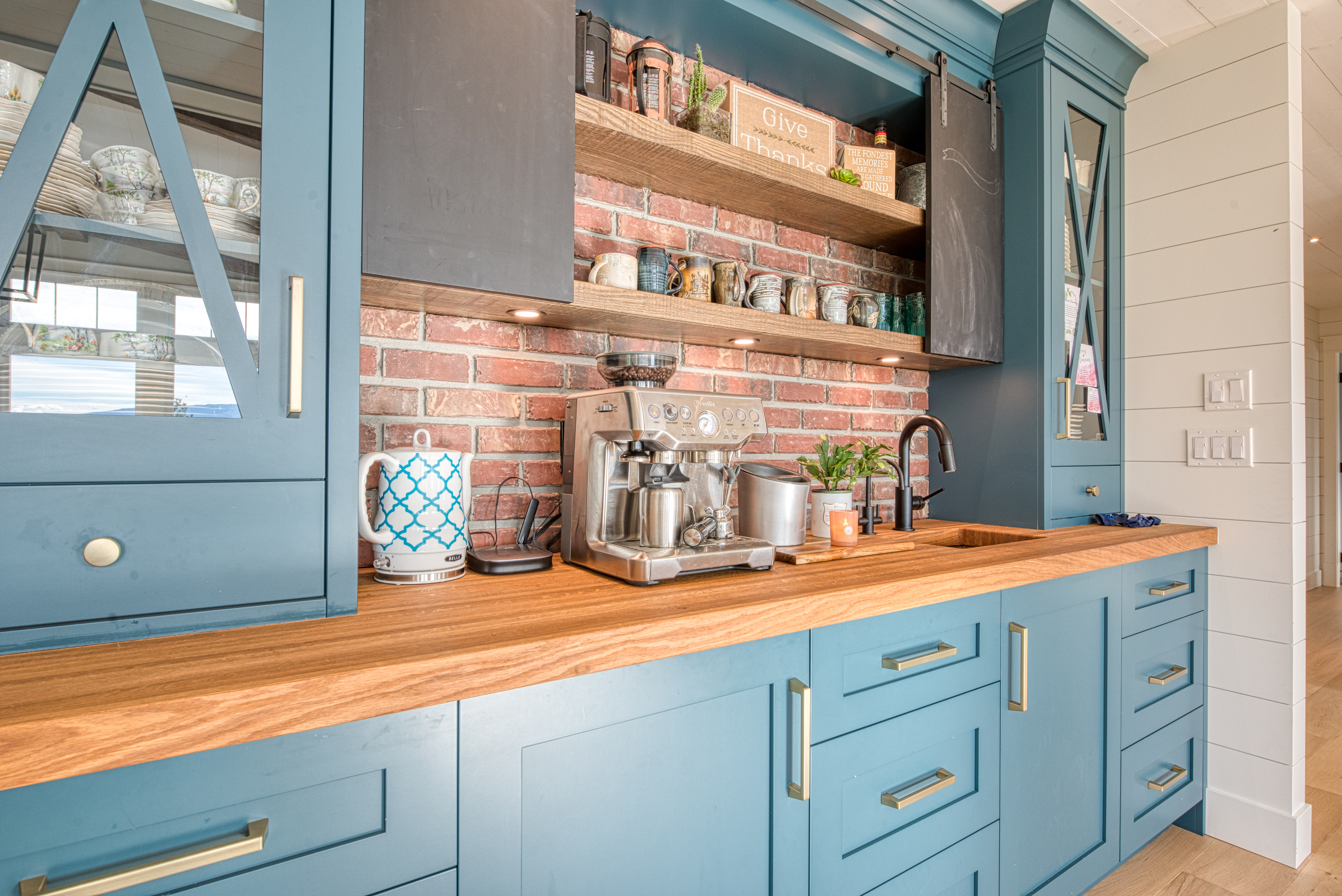 custom blue painted coffee bar with rough sawn shelves and countertop