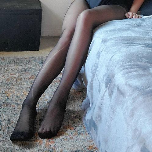 Ripped black nylon pantyhose