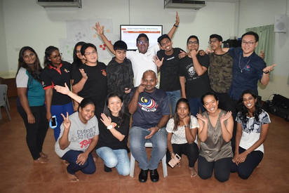 Father Simon Anand with the young people