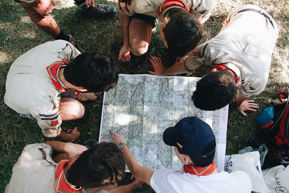 Scouts-viewing-map-outdoors