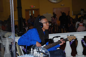 Damarius Young on bass guitar