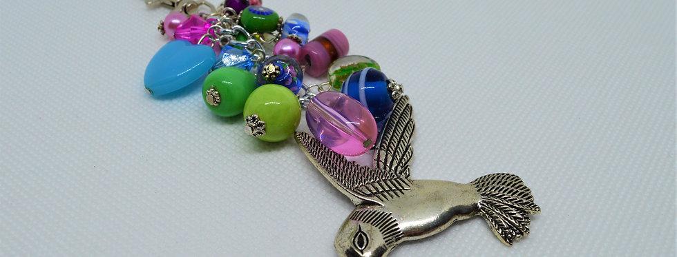 pastel humming bird charm
