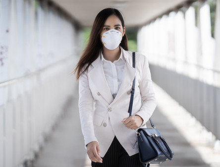 Asian woman are going to work.she wears