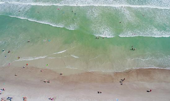 Aerial view of people in surf