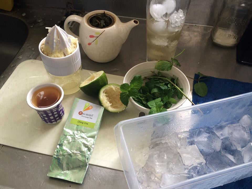 Ingredients, including our Ching Cha tea, mint, lime, rum and ice.